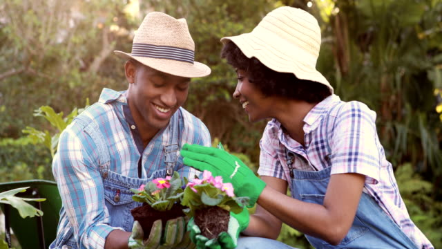 Happy-couple-gardening-in-the-park
