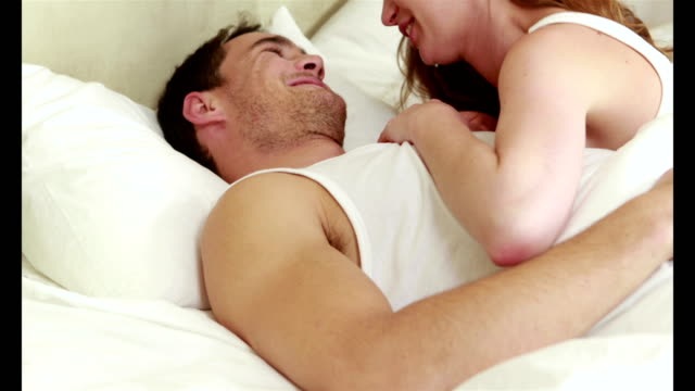 Affectionate-couple-on-their-bed