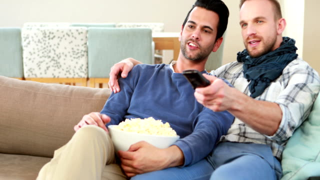 Homosexual-couple-men-eating-popcorn-together