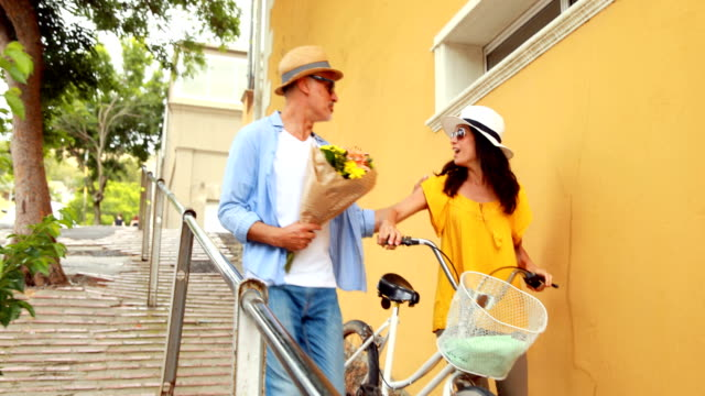 Man-giving-flowers-to-a-woman