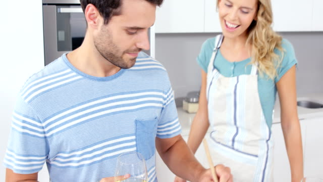 Cute-couple-embracing-and-preparing-the-meal