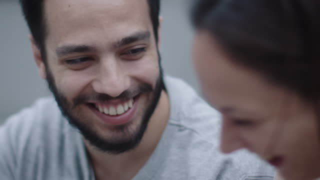 Young-Happy-Smiling-Man-and-Woman-are-Communicating-Outdoors-Close-up-Slow-Motion-Shot-