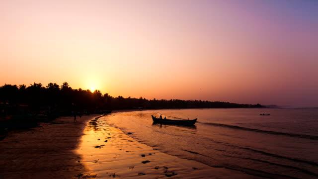 Fishermen-go-to-sea-in-in-boat-sunrise