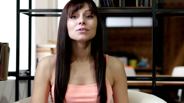 Skype-Woman-Doing-Online-Video-chat-Indoor-Office