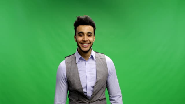 Businessman-Offer-Hand-For-Handshake-Happy-Smiling-Portrait-Young-Latin-Business-Man-Handshaking-Welcome-Over-Chroma-Key-Green-Screen