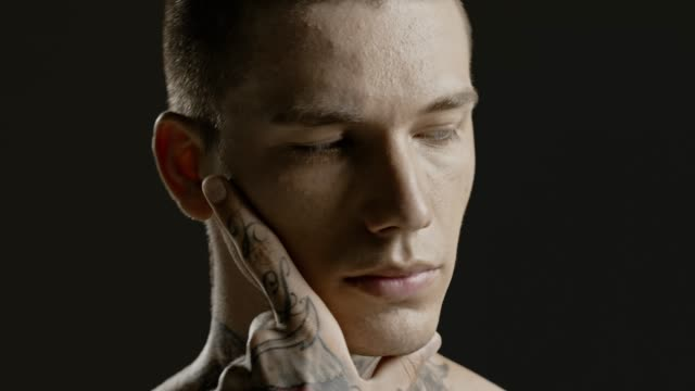 Handsome-sexy-young-man-stylish-with-tattoo-on-his-neck-torso-and-hand---ultra-close-up-body-and-face-detail---greenscreen-Prores---cinematic-lighting