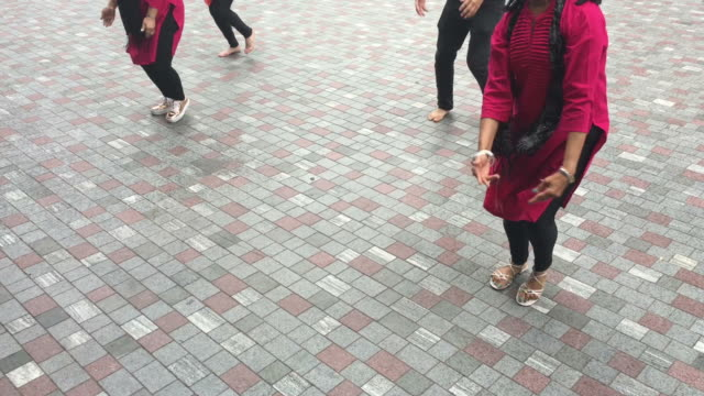 Unrecognizable-Indian-people-dancing-in-the-street
