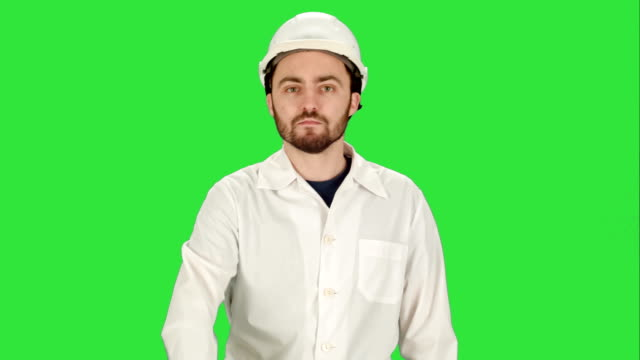 Man-in-the-construction-helmet-with-a-raised-finger-on-a-Green-Screen-Chroma-Key