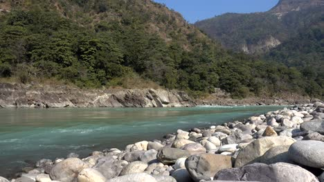 Holy-Ganges-river-flowing-among-the-green-mountains-of-Rishikesh-India-