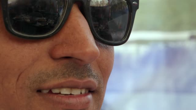 Extreme-closeup-of-a-handsome-dude-male-wearing-dark-glasses-smug-sexy-and-confident-in-Rajasthan-India