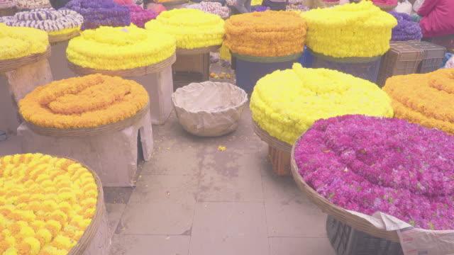 Multicoloured-fresh-flower-garland-kept-in-the-basket-for-selling-in-KR-flower-market-India