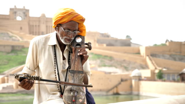An-Old-traditional-man-playing-Sarangi-against-the-historic-fort-