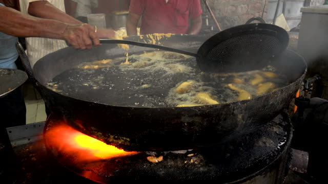 Some-people-are-cooking-the-Chilly-Bhajji-is-a-Deep-Fried-Peppers-delicious-street-food-famous-in-India-