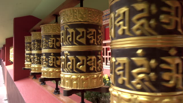 Some-Tibetan-prayer-wheels-are-turning-in-a-Buddhist-temple-in-India-