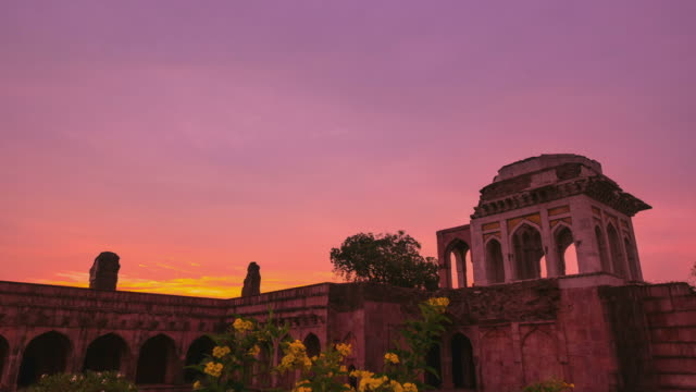Time-lapse-Mandu-India-afghan-ruins-of-islam-kingdom-mosque-monument-and-muslim-tomb-Colorful-sky-at-sunrise-