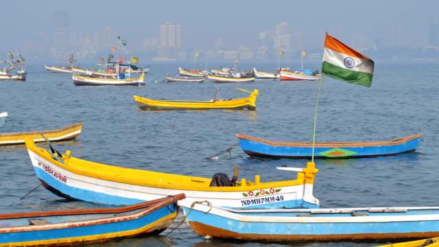 Indian-flag-waving-on-parked-fishing-boat-in-Mumbai-India
