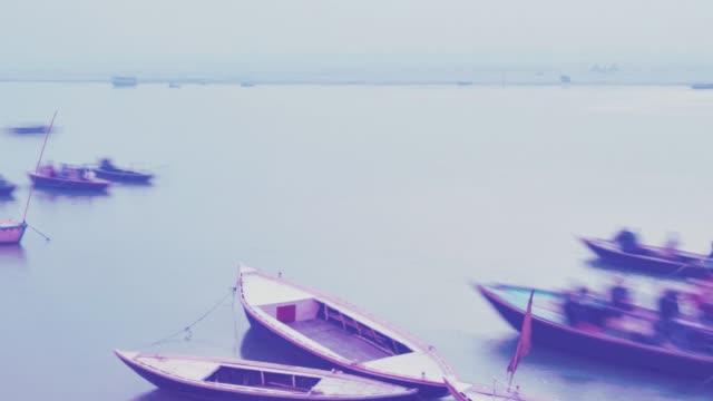 Indian-pilgrims-rowing-boat-in-dawn-Ganges-river-in-Varanasi-India-