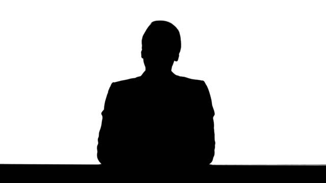 Silhouette-Young-beautiful-television-announcer-giving-a-speach