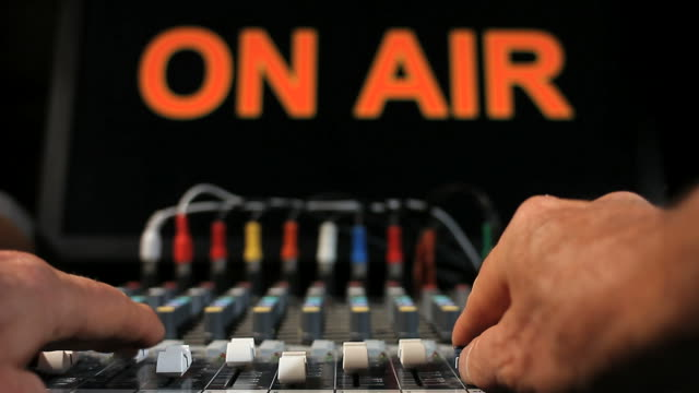 """HANDS-MOVE-FADERS-ON-MIXING-BOARD-""""ON-AIR"""""""
