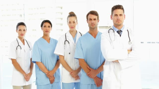 Frowning-medical-team-with-hands-together