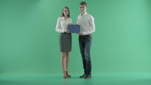 businessmen-and-blue-card-n-a-green-screen