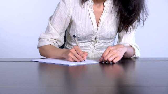 woman-writing-white-paper