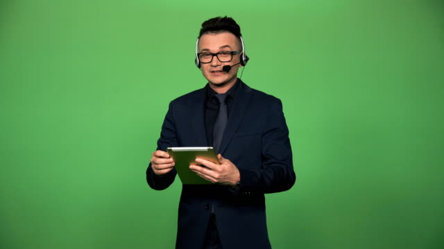 Newscaster-with-tablet-and-headset
