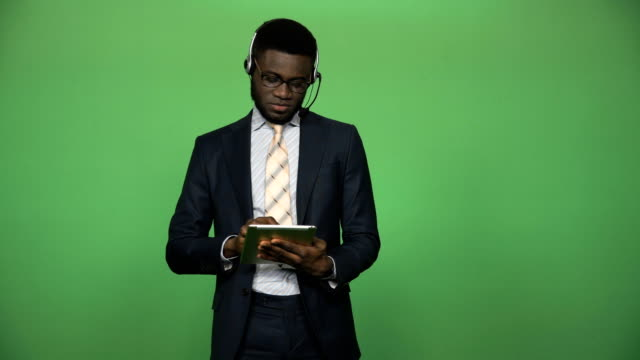 African-male-support-call-center-with-tablet-and-headset