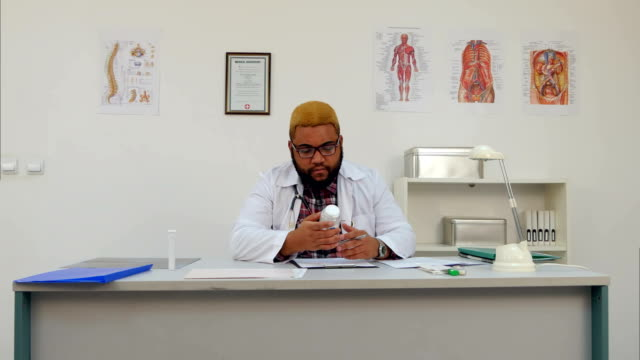 African-american-male-medical-worker-prescribing-pills-and-filling-in-form