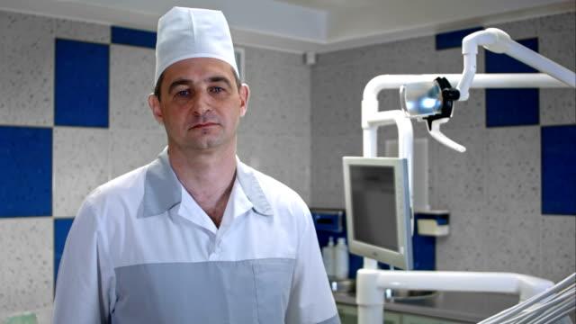 Worried-man-doctor-looking-at-camera