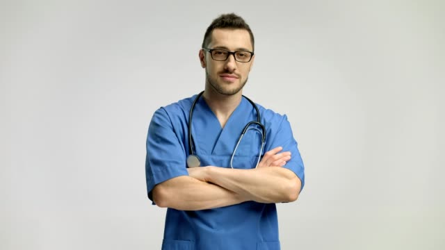 Doctor-folding-his-arms-and-smiling