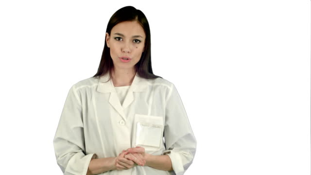 Serious-woman-in-lab-coat-talking-to-the-camera-on-white-background