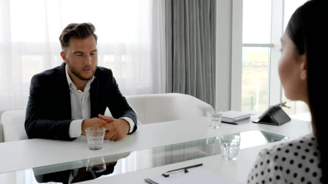 conversation-of-unhappy-guy-and-psychologist-sitting-at-table-Man-in-depressed-Talks-about-problems-with-woman