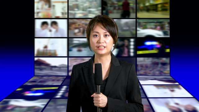 News-presenter-in-studio-with-banks-of-screens-in-background