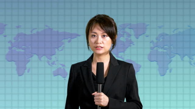 News-anchor-in-studio-with-map-display-in-background