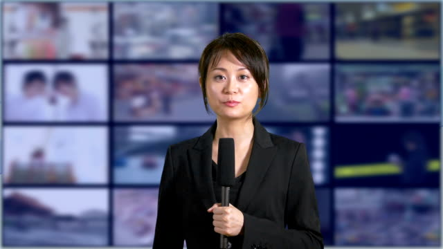 News-anchorwoman-in-studio-with-banks-of-screens-in-background