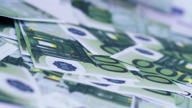 Red-dice-falling-on-euro-money