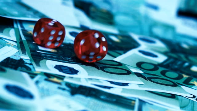 Red-dice-falling-on-100-euro-money-bill