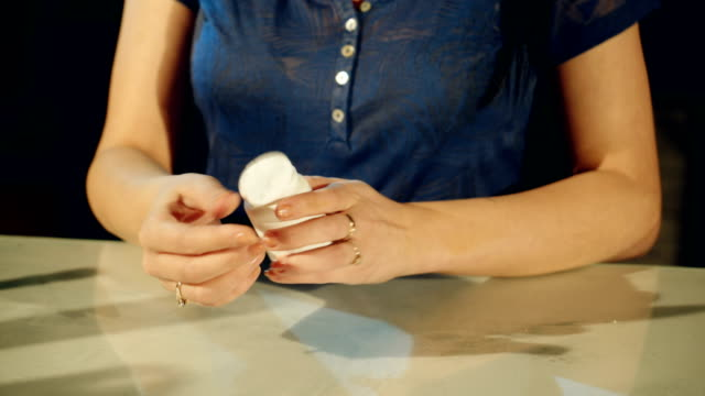 Young-woman-taking-pills-