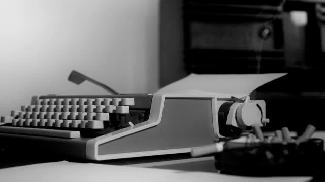 Vintage-typewriter-and-smoking-cigarette