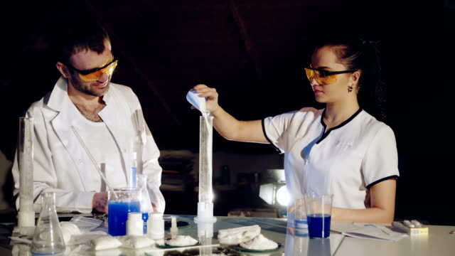 Two-scientists-are-working-in-laboratory-
