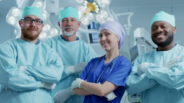 Diverse-Team-of-Professional-surgeon-Assistants-and-Nurses-Standing-Proudly-with-Crossed-Arms-in-the-Real-Modern-Hospital-with-Authentic-Equipment-