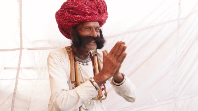 Smiling-man-from-Rajasthan-with-big-moustache-and-hands-joined-in-namaste-welcoming-guests