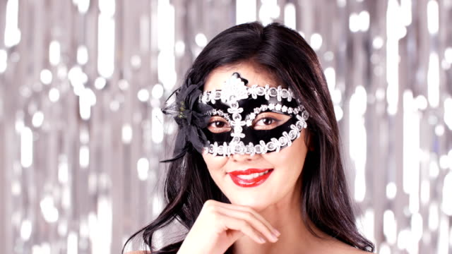 Beautiful-woman-posing-with-mask-in-party-event-Attractive-woman-wearing-mask-at-night-party-People-with-party-celebration-new-year-concept-