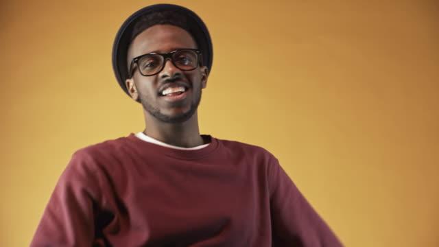 Cheerful-Black-Man-Gesturing-before-Camera