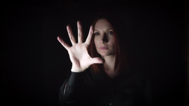 4K-Portrait-of-a-Woman-Gesturing-with-Hand-on-Invisible-Button
