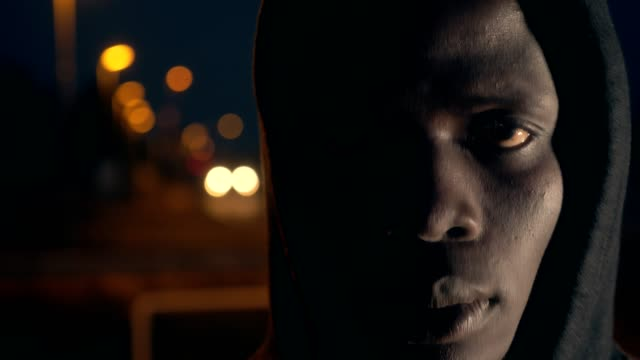 Sad-lonely-american-african-man-staring-at-camera-slow-motion-city-night