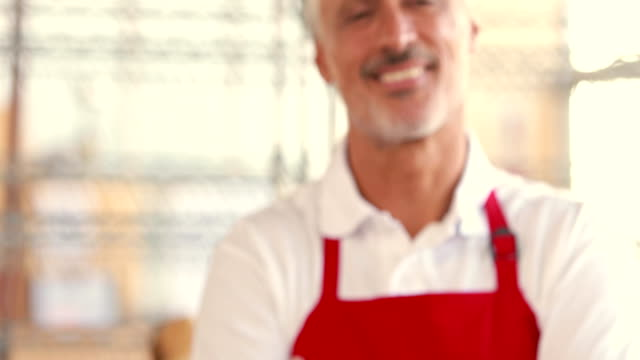 Happy-server-looking-at-camera-with-arms-crossed