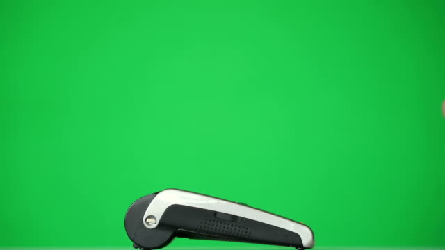 Concept-NFC-contactless-payment-Making-payment-with-credit-card-and-pos-terminal-printed-check-