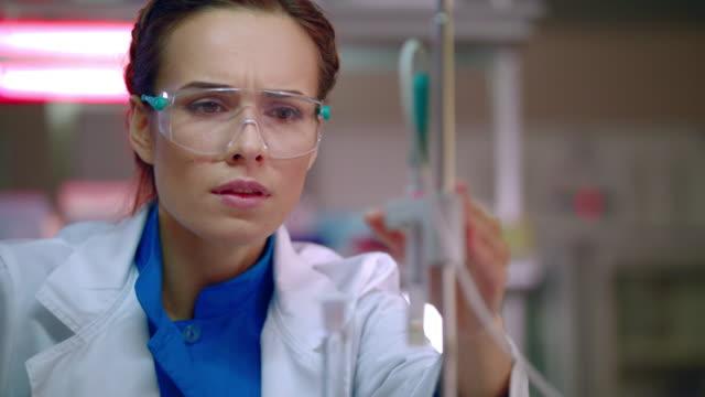Female-researcher-preparing-for-lab-research-Closeup-of-laboratory-researcher